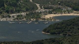 FG0001_000132 - 4K stock footage aerial video of watercraft near the marina and the beach on Silverwood Lake, California