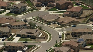 FG0001_000145 - 4K stock footage aerial video of residential neighborhood with quiet streets in Rancho Cucamonga, California