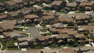 FG0001_000148 - Aerial stock footage of Spacious homes in a suburban neighborhood in Rancho Cucamonga, California