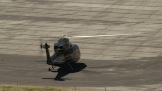 FG0001_000153 - 4K stock footage aerial video of a helicopter at Whiteman Airport, Pacoima, California