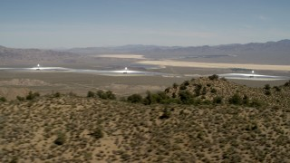 FG0001_000164 - 4K stock footage aerial video of towers and arrays of the Ivanpah Solar Electric Generating System, California