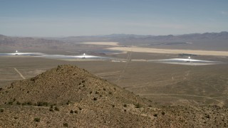 FG0001_000166 - Aerial stock footage of The three towers and arrays of the Ivanpah Solar Electric Generating System, California