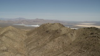 FG0001_000169 - 4K stock footage aerial video of desert mountains and the Ivanpah Solar Electric Generating System in California