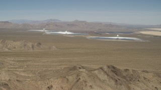 FG0001_000172 - 4K stock footage aerial video of approaching the Ivanpah Solar Electric Generating System in California
