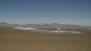 FG0001_000175 - 4K stock footage aerial video tilt from blue sky to reveal Ivanpah Solar Electric Generating System in California