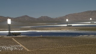 FG0001_000180 - 4K stock footage aerial video of row of power towers and mirrors of the Ivanpah Solar Electric Generating System in California