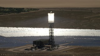 FG0001_000186 - 4K stock footage aerial video orbit one of the power towers at the Ivanpah Solar Electric Generating System in California