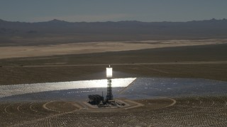 FG0001_000188 - 4K stock footage aerial video of orbiting one of the arrays at the Ivanpah Solar Electric Generating System in California