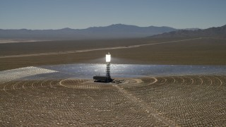 FG0001_000190 - 4K stock footage aerial video of an orbit around one of the arrays at the Ivanpah Solar Electric Generating System in California