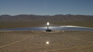 FG0001_000192 - 4K stock footage aerial video of circling around an array at the Ivanpah Solar Electric Generating System in California