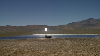 FG0001_000193 - 4K stock footage aerial video tilt to reveal and orbit an array at the Ivanpah Solar Electric Generating System in California