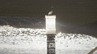FG0001_000202 - Aerial stock footage of A power tower boiler on one of the arrays at the Ivanpah Solar Electric Generating System in California