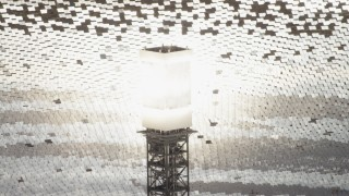 FG0001_000205 - 4K stock footage aerial video of glowing power tower boiler at the Ivanpah Solar Electric Generating System in California