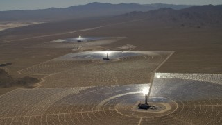 FG0001_000210 - 4K stock footage aerial video of a view of the three solar power structures at the Ivanpah Solar Electric Generating System in California