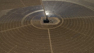 FG0001_000211 - 4K stock footage aerial video of looking down at one of the solar power structures at the Ivanpah Solar Electric Generating System in California