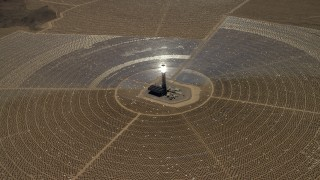 FG0001_000213 - 4K stock footage aerial video tilt to reveal and approach one of the solar power structures at the Ivanpah Solar Electric Generating System in California