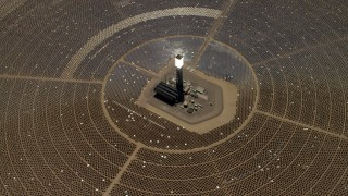 FG0001_000214 - Aerial stock footage of Tilt to bird's eye of one of the solar power structures at the Ivanpah Solar Electric Generating System in California