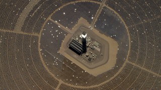 FG0001_000215 - 4K stock footage aerial video of a bird's eye of one of the solar power structures at the Ivanpah Solar Electric Generating System in California