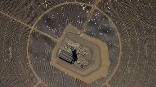 FG0001_000218 - 4K stock footage aerial video of a bird's eye view of one of the mirror arrays and power towers at the Ivanpah Solar Electric Generating System in California