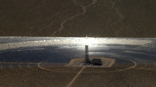 FG0001_000223 - 4K stock footage aerial video zoom to a mirror array and power tower at the Ivanpah Solar Electric Generating System in California