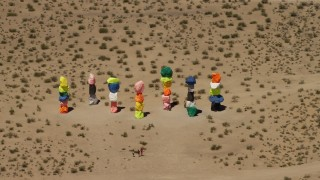FG0001_000225 - 4K stock footage aerial video of Seven Magic Mountains rock formation in the desert outside of Las Vegas, Nevada