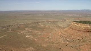 FG0001_000227 - 4K stock footage aerial video approach a dry riverbed running through the Arizona Desert