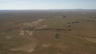 FG0001_000230 - 4K stock footage aerial video of a dry riverbed and a desert plain in the Arizona Desert