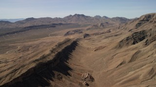 FG0001_000254 - 4K stock footage aerial video of a view across rough desert mountains in the Nevada Desert