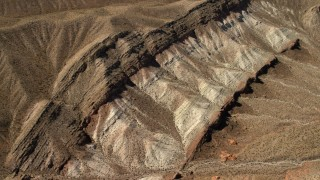 FG0001_000266 - 4K stock footage aerial video tilt to a bird's eye view of a scarred hillside in the Nevada Desert