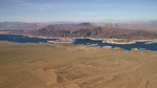 FG0001_000269 - 4K stock footage aerial video of approaching the Lower Narrows arm of Lake Mead in the Nevada Desert
