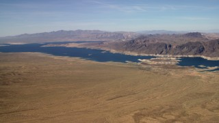 FG0001_000270 - 4K stock footage aerial video pan and approach the Lower Narrows arm of Lake Mead in the Nevada Desert