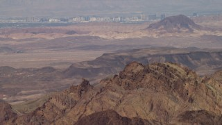 FG0001_000291 - 4K stock footage aerial video tilt from desert mountains to reveal the casino hotels of Las Vegas, Nevada