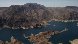 FG0001_000296 - Aerial stock footage of A view of tall desert mountains on the opposite shore of Lake Mead, Nevada