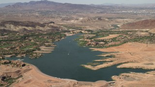 FG0001_000300 - 4K stock footage aerial video of lakefront homes and Westin resort spa on Lake Las Vegas in Henderson, Nevada