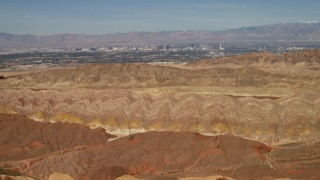 FG0001_000301 - 4K stock footage aerial video tilt from barren desert mountains to reveal Las Vegas, Nevada