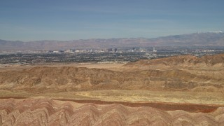 FG0001_000302 - 4K stock footage aerial video fly over barren desert mountains to approach Las Vegas, Nevada