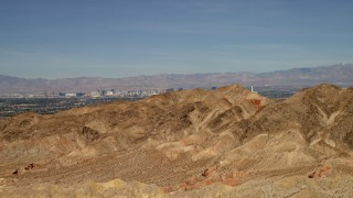 FG0001_000305 - 4K stock footage aerial video approach desert mountains with the city of Las Vegas, Nevada in the background