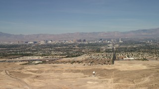 FG0001_000306 - 4K stock footage aerial video fly over a desert mountain to reveal the city of Las Vegas, Nevada