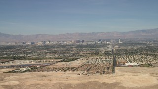 FG0001_000307 - 4K stock footage aerial video approach suburban neighborhoods with the casino hotels in the background, Las Vegas, Nevada