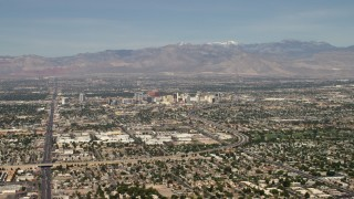 FG0001_000311 - 4K stock footage aerial video of Downtown Las Vegas hotels and casinos seen from I-515 and suburban neighborhoods, Nevada