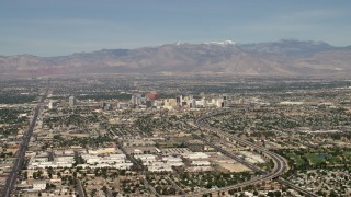 FG0001_000312 - 4K stock footage aerial video approach Downtown Las Vegas hotels and casinos from I-515, Nevada