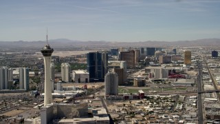 FG0001_000319 - 4K stock footage aerial video pass by Stratosphere, with a view of hotels and casinos on the Las Vegas Strip in Nevada