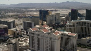 FG0001_000325 - 4K stock footage aerial video of Paris Las Vegas and Planet Hollywood seen from Caesar's Palace and the Bellagio on the Las Vegas Strip in Nevada