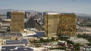 FG0001_000330 - 4K stock footage aerial video flyby the Delano, Luxor and Mandalay Bay, and reveal Las Vegas Boulevard on the Las Vegas Strip, Nevada