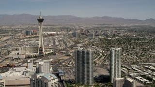 FG0001_000339 - 4K stock footage aerial video approach Stratosphere with Downtown Las Vegas casinos in the background, Nevada