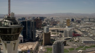 FG0001_000342 - 4K stock footage aerial video flyby the top of Stratosphere Las Vegas, Nevada, and focus on casino resorts on the Las Vegas Strip
