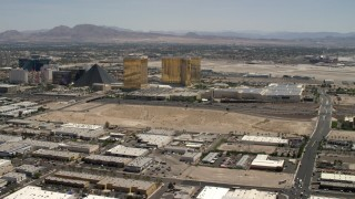 FG0001_000352 - 4K stock footage aerial video of an open dirt lot beside I-15 with light traffic in Las Vegas, Nevada and casino resorts on the Strip
