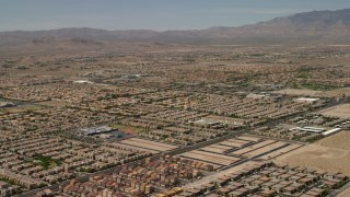 FG0001_000356 - 4K stock footage aerial video fly over neighborhoods with tract homes and approach an elementary school in Las Vegas, Nevada