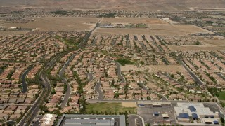 FG0001_000358 - Aerial stock footage of Fly over and pan across neighborhoods with tract homes and apartment buildings in Las Vegas, Nevada