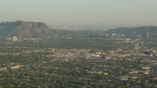 HDA06_01 - 1080 stock footage aerial video fly over North Hollywood toward Mount Lee and Downtown Los Angeles, California, sunset